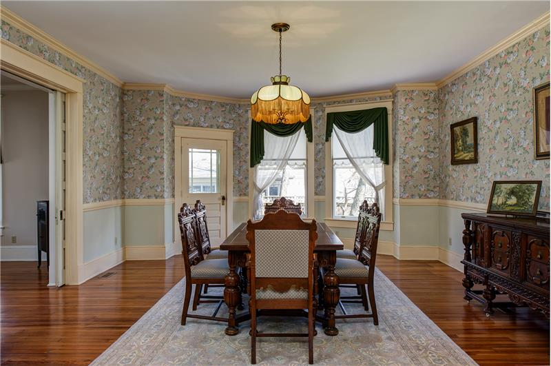 Pocket doors take you from the living to your formal dining room with bay window