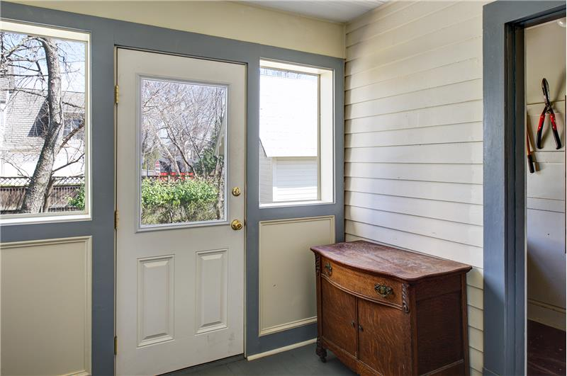 You'll love the side porch with pottig shed