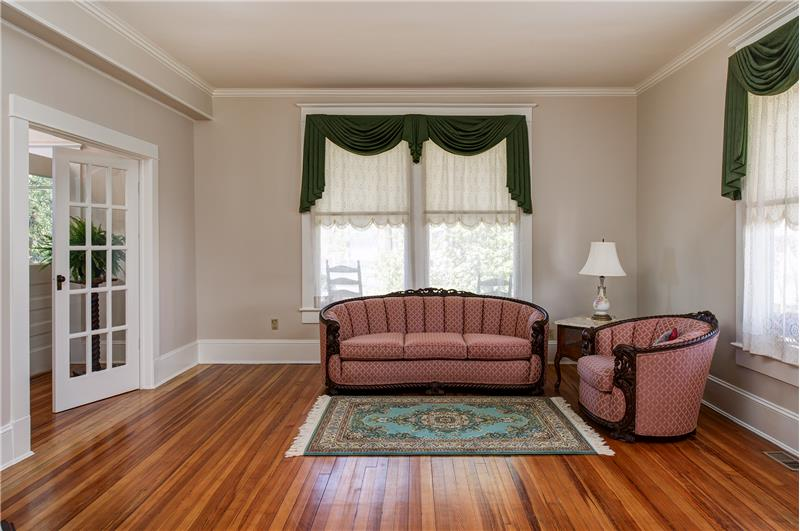 From the foyer, walk through the double french doors to the formal living room