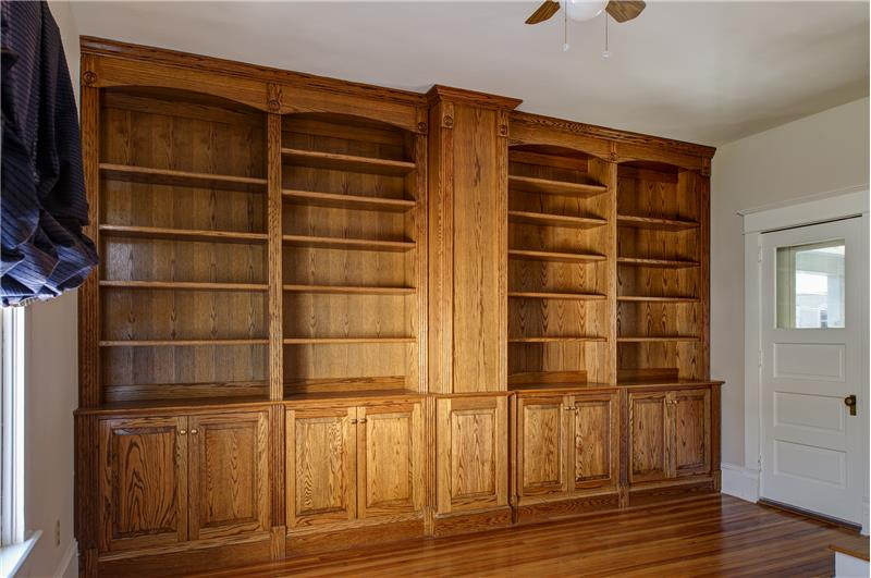 Beautiful built-in bookshelves and cabinetry in the library