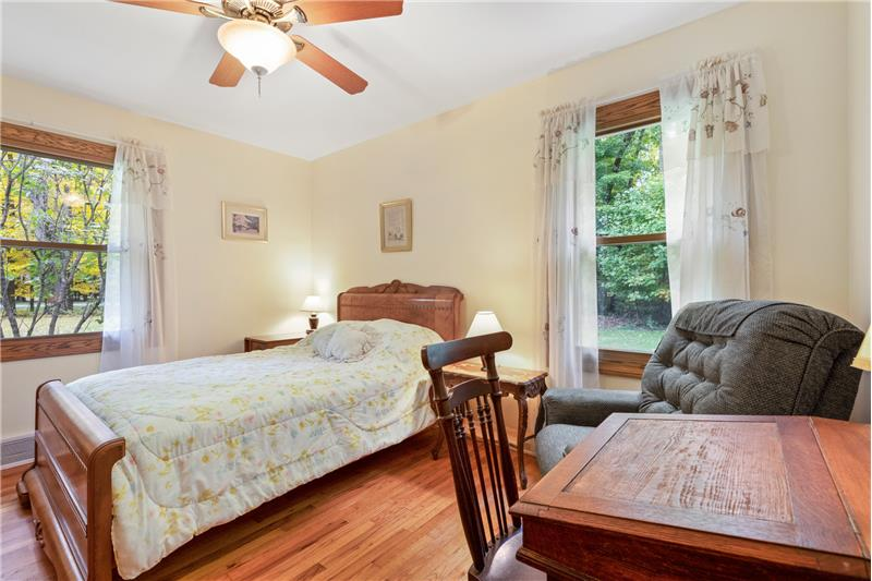 All bedrooms have wood floors and ceiling fans