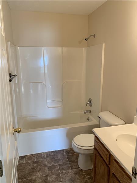 Full bath off hallway with tub/shower and NEW flooring