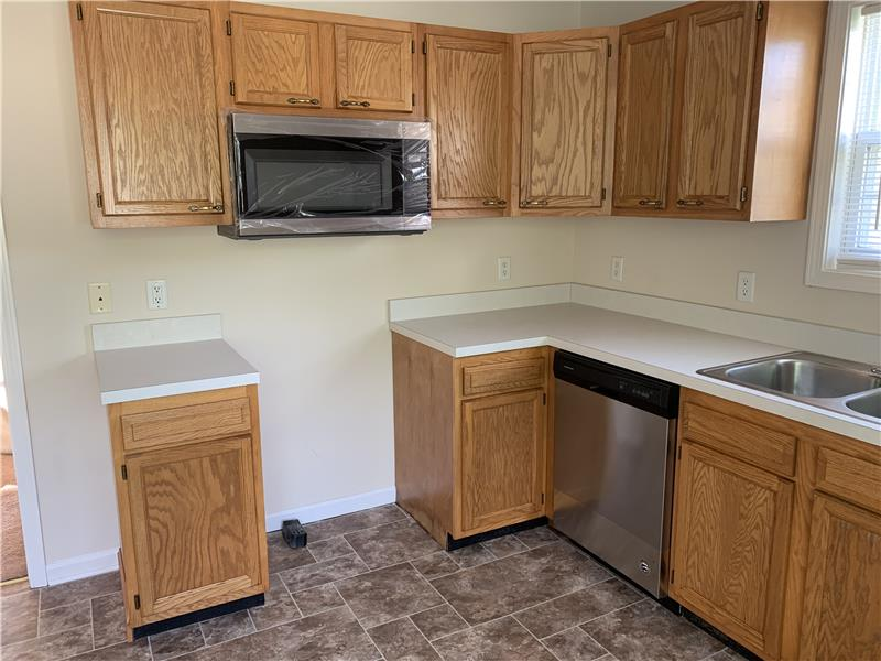 NEW stainless microwave hood and dishwasher