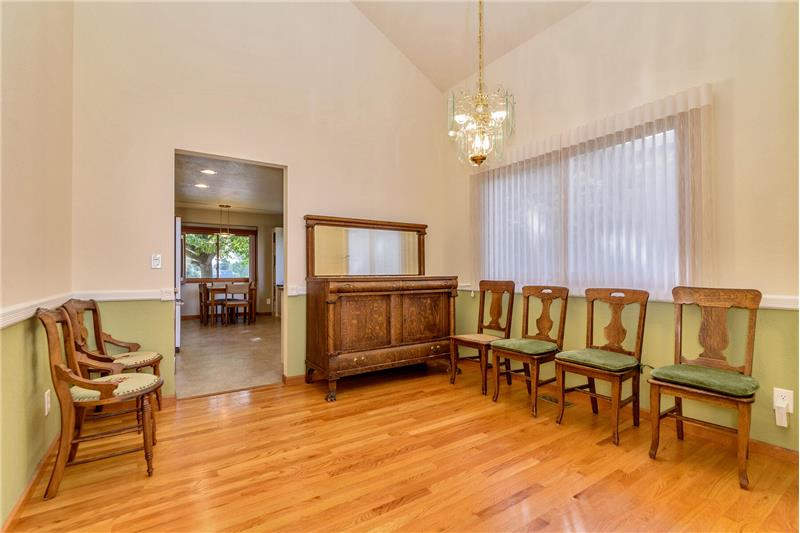 Dining room, with kitchen beyond