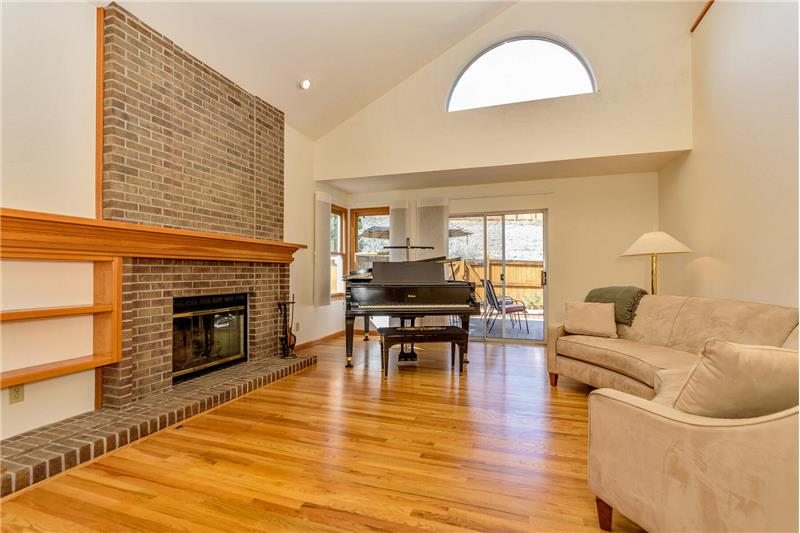 Living room with gas fireplace and door to backyard