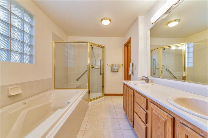 5-piece master bathroom has separate room for toilet
