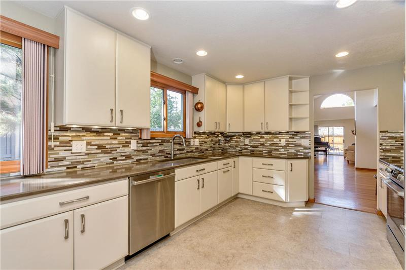 Kitchen has Caesarstone countertops and sink (similar to Silestone)