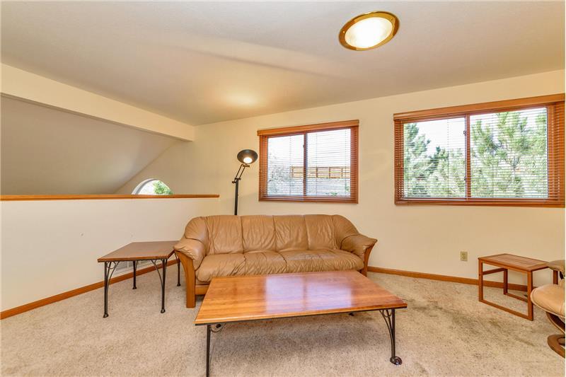 Loft has windows to backyard and overlooks the living room