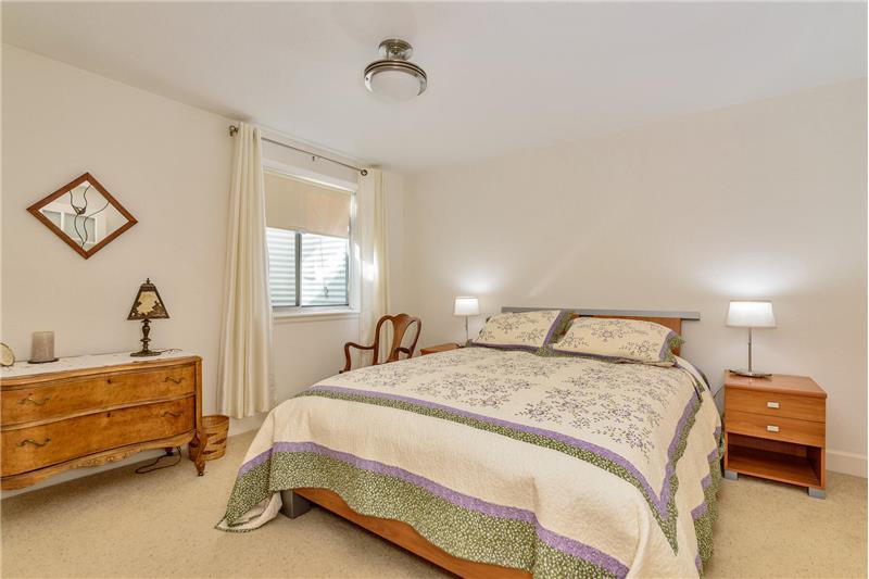 3rd bedroom in basement has walk-in closet, French doors, and egress window