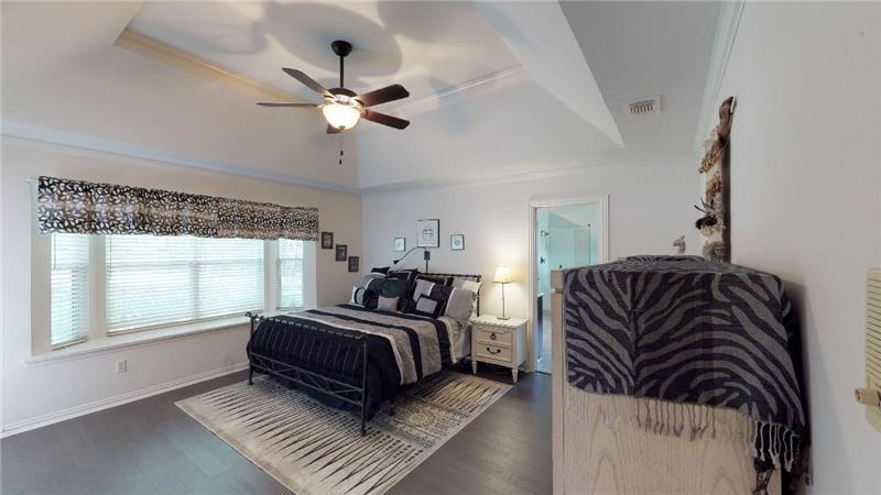 Beautiful master bedroom with wall of windows