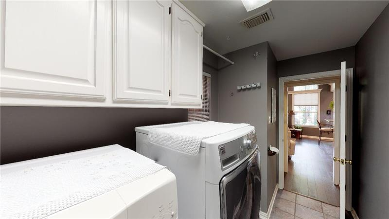 Cabinets, hanging space, and a utility sink!
