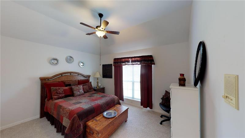 One of two secondary bedrooms upstairs