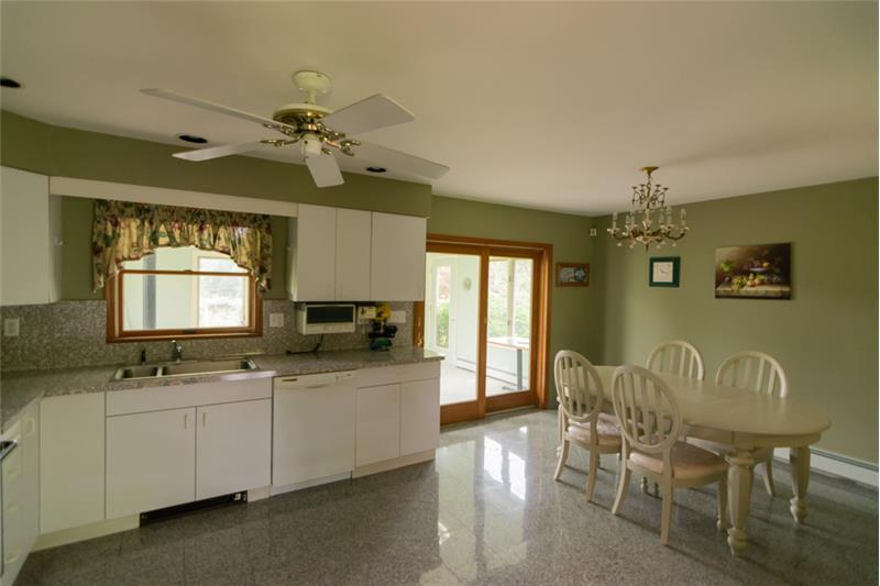 Kitchen with granite flooring