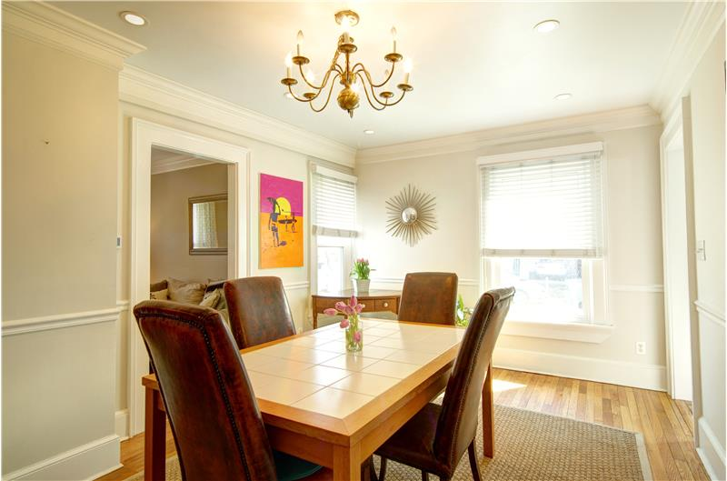 Dining Room with Crown Molding & High Ceilings