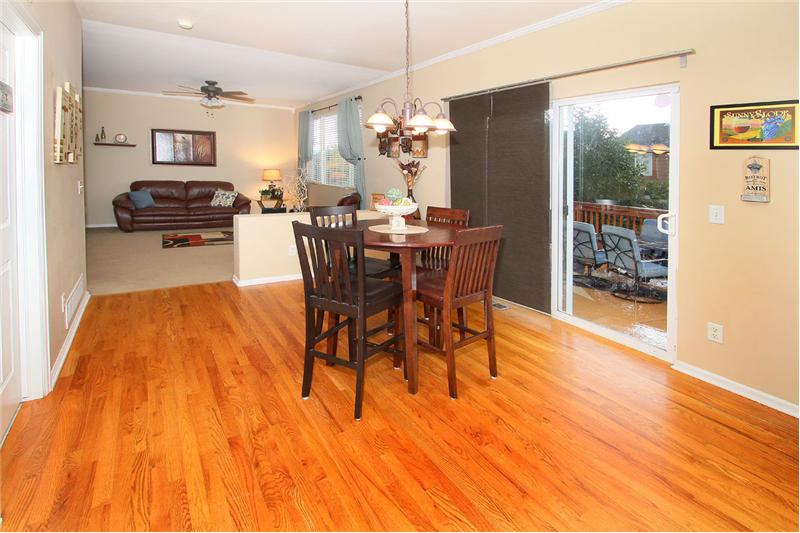 Hardwood flooring in kitchen and dining area