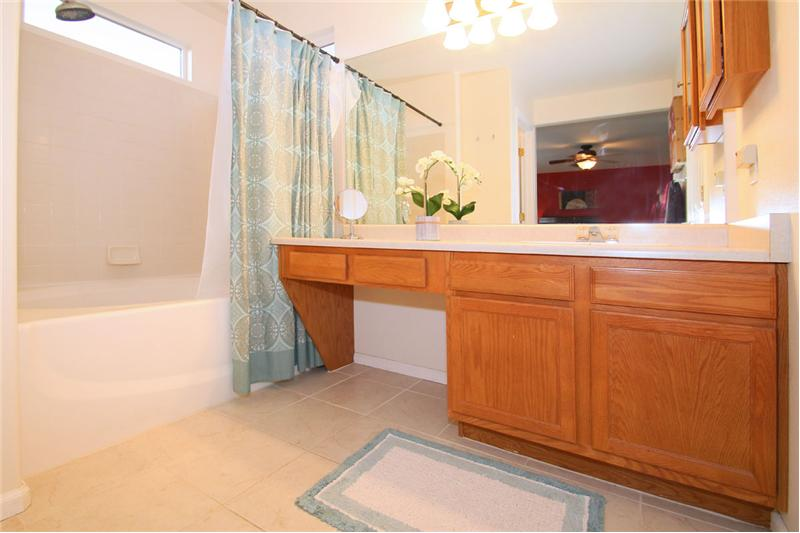 Master Bath with a garden tub, tile flooring with radiant heat, and a walk in closet