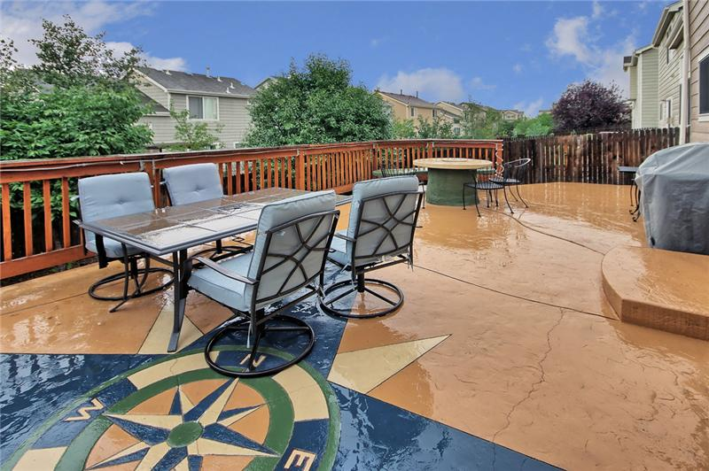 The expansive patio is great for entertaining with a gas fire pit and hot tub!