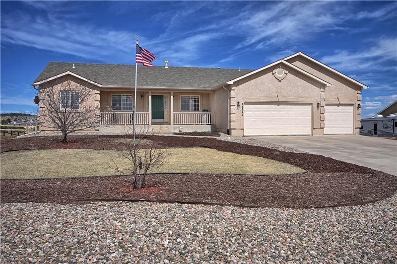 5 bedroom home on a 1/2 acre lot that backs to open space!