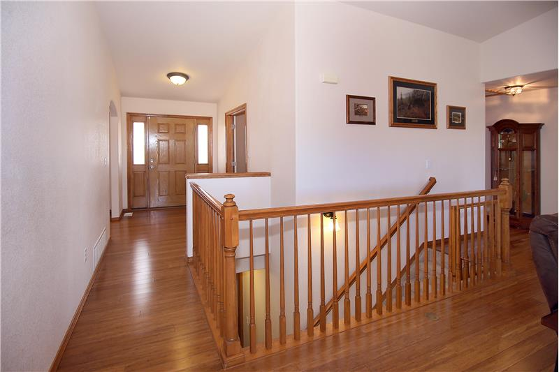 View of entryway and bamboo flooring on main level