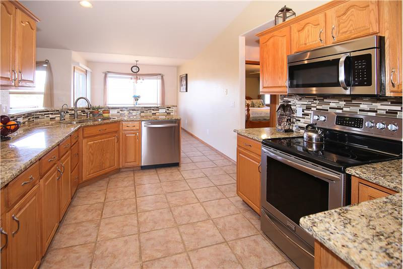 Kitchen offers ample counter top space and cabinet storage.