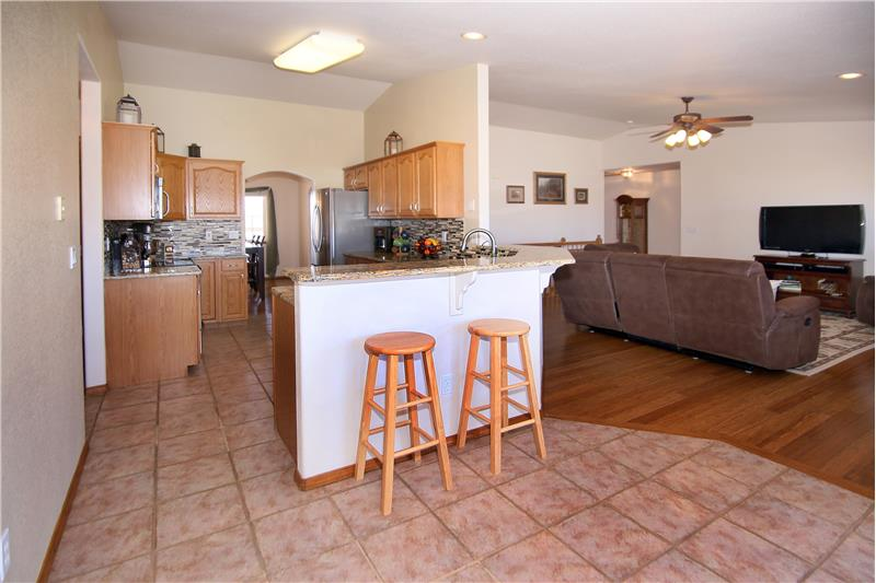 Kitchen has tile flooring, a breakfast bar, and pantry