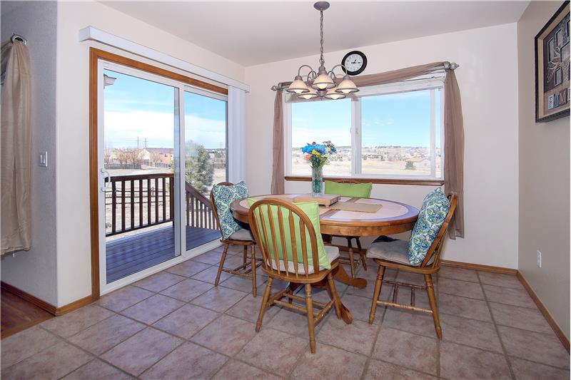 Breakfast nook with tile flooring walks out to wood deck
