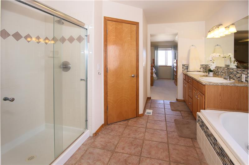 Large shower! His and her walk in closets!