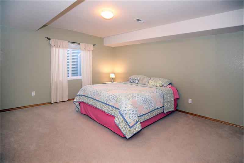 Large fifth bedroom in basement