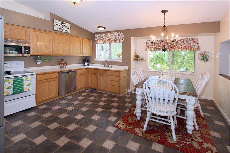 Spacious eat-in kitchen with tile flooring!