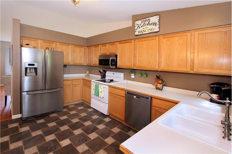 Stainless steel appliances and a smooth top oven range