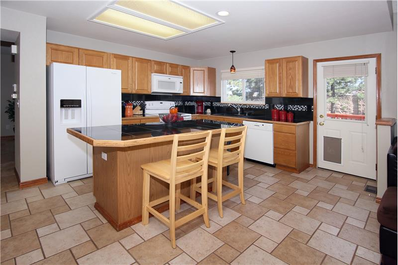 Kitchen with island with breakfast bar