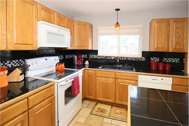 Granite tile counter top and backsplash. A gas line is also available for a gas stove!