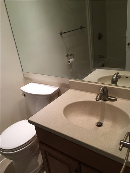 Renovated quartz full bathroom with shower & tub