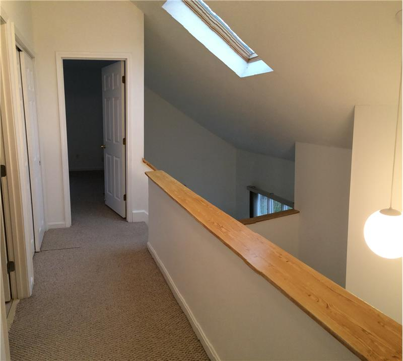 Upstairs with loads of light via skylights