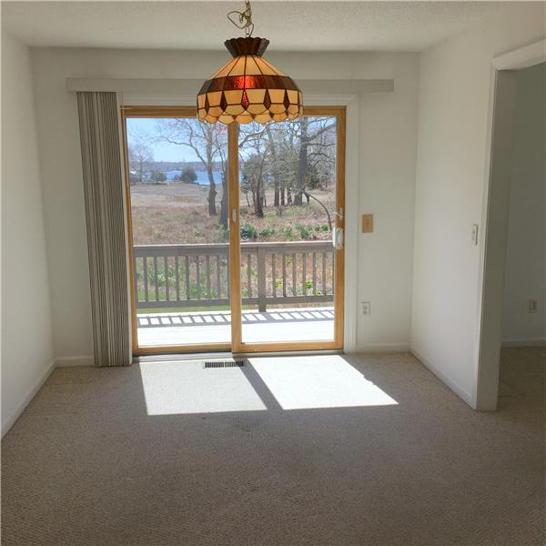 Dining room off kitchen...water view of Wickford. Oil heat & central air here!