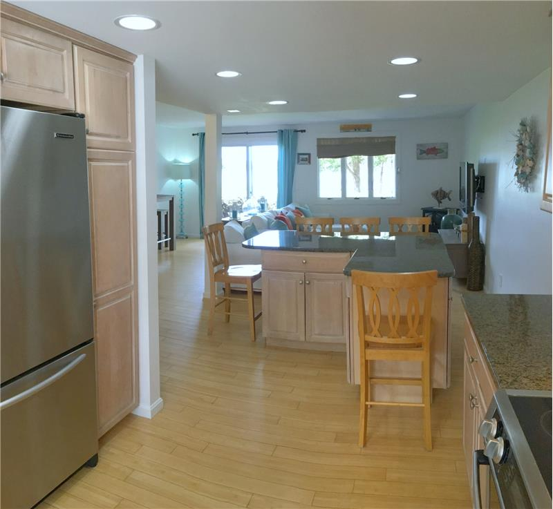 Kitchen to dining to living rooms & water views