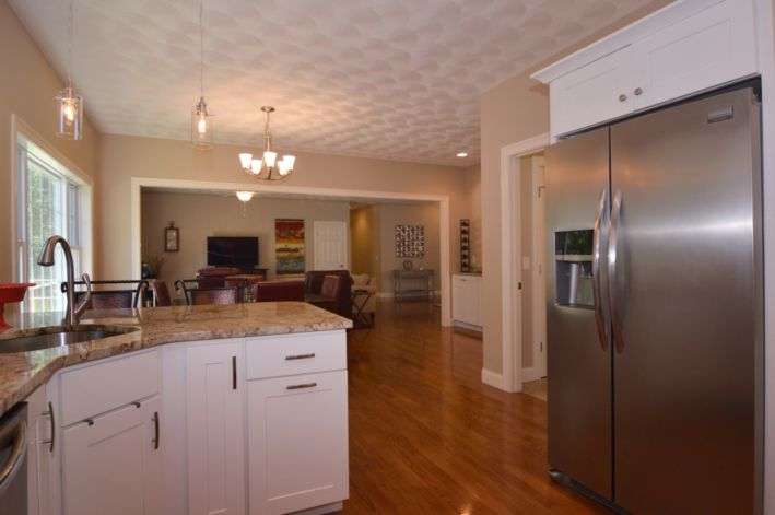 Kitchen is open to dining/living rooms