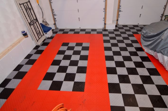 double garage with tiled floor; yes it fits your Suburban!