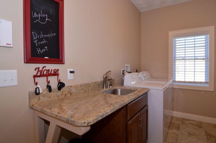 Full granite applianced laundry room off kitchen