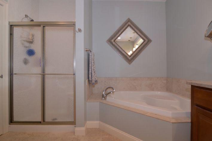 Soaking tub & shower; walk in large closets