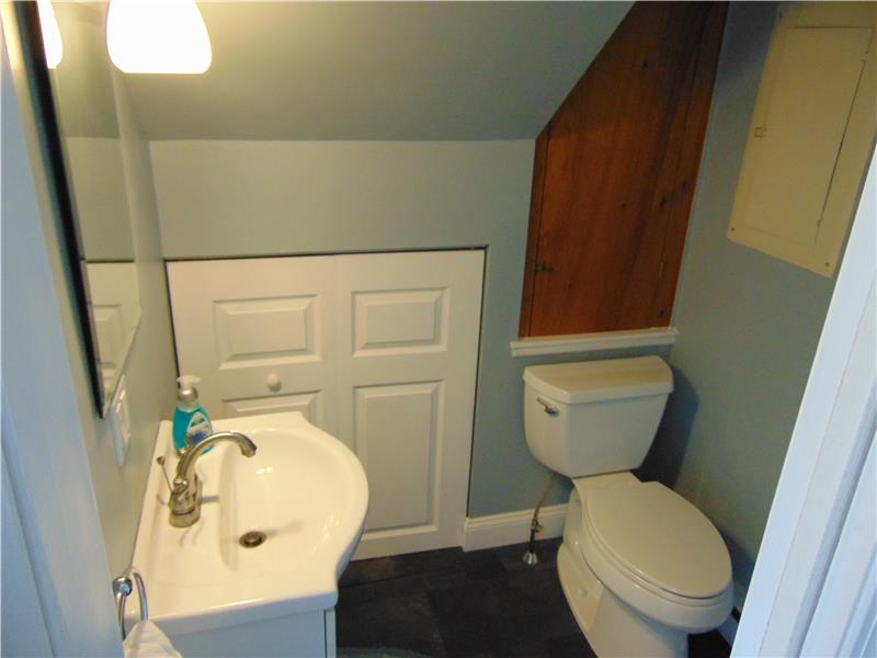 Half bath with cedar closet, storage & access to basement
