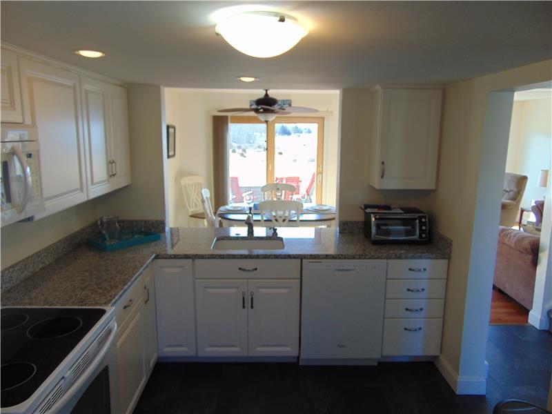 Kitchen sink water views in your granite & new applianced kitchen