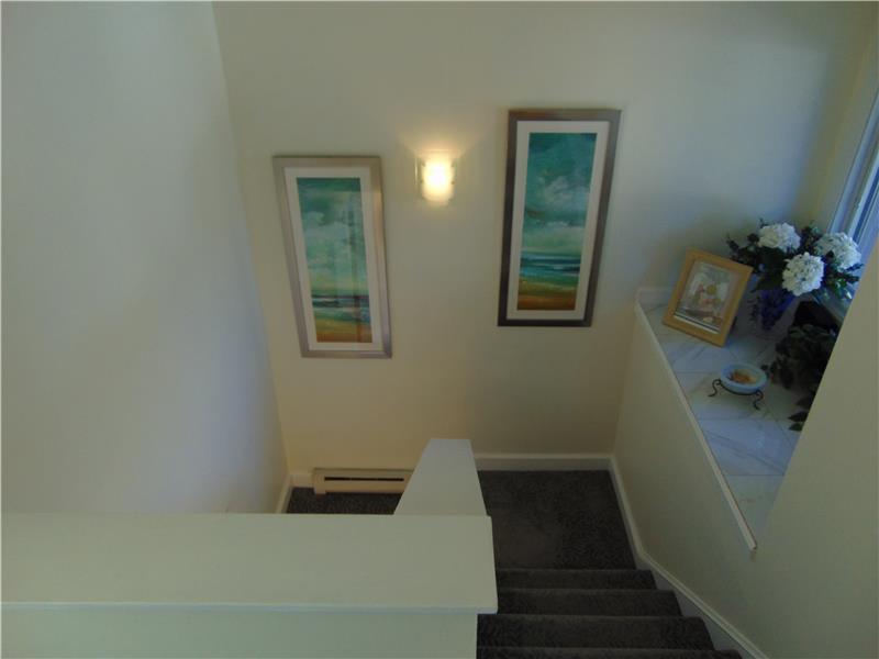 Striking light filled wide stairway to second floor