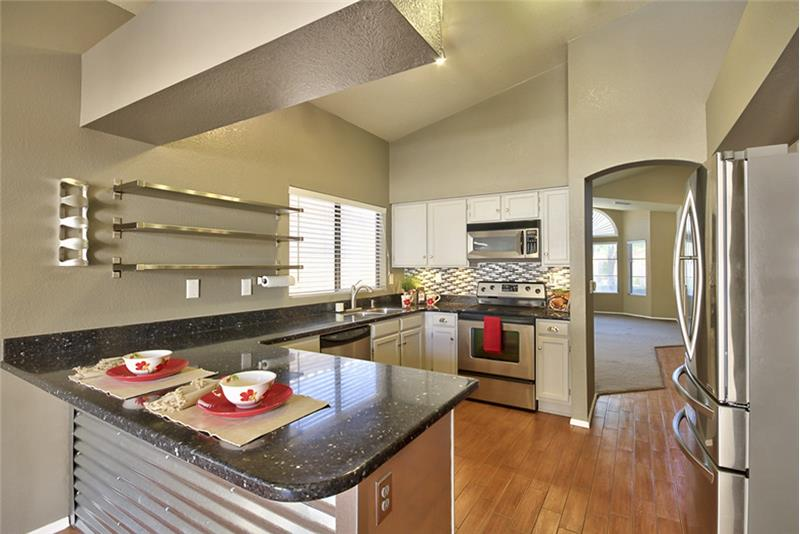 Kitchen features tons of cabinet space