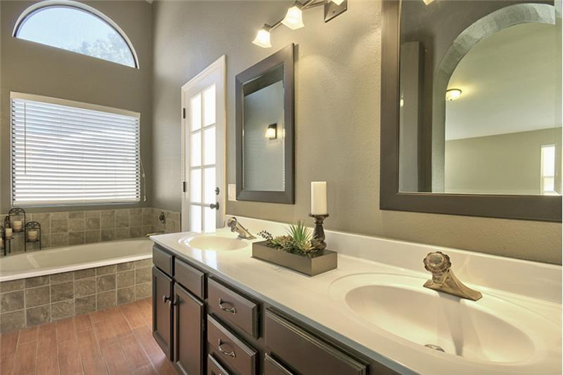Beautifully designed master bathroom with double sinks.