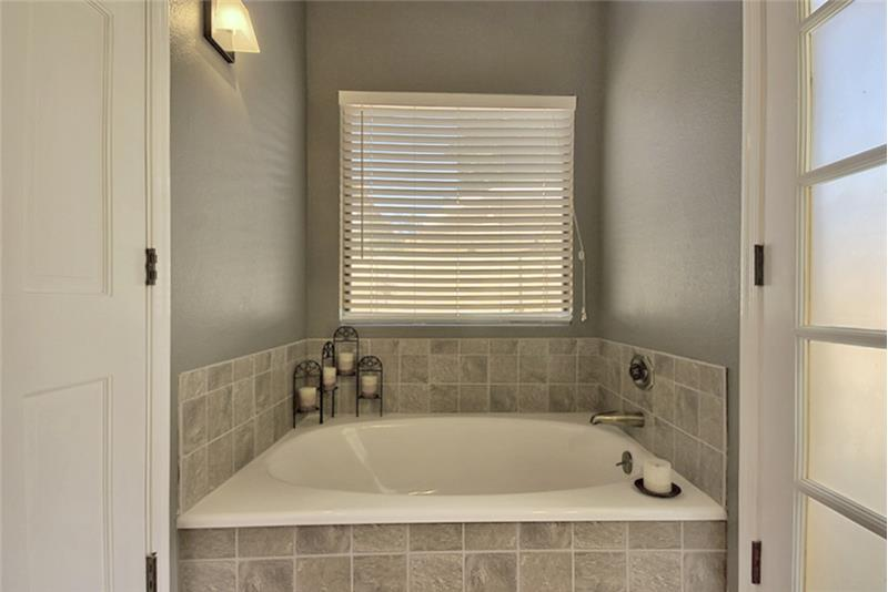 Relax in this soaking tub within your master bathroom