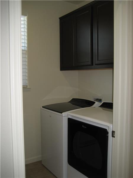 Laundry Room With Cabinets & Gas Line for Dryer.  Washer & Dryer Not Included