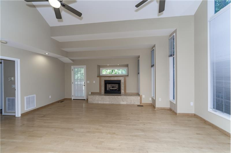 Large fireplace with tri-step design surrounding the family room