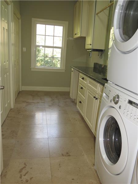Large laundry room w cabinets tile floors window...