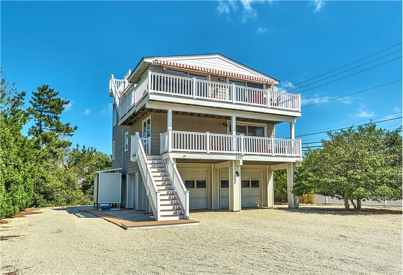 2-Level Contemporary located just 1 block to the life-guarded ocean and 1 block to the bay beach on the north side of the street